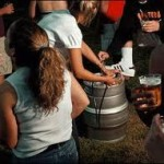 Underage teenagers drinking beer at a party.