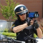a bowling green va police officer with radar gun checking for speeding drivings on i 95 in bowling green va you need a speeding ticket lawyer
